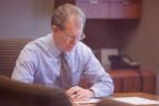 Stuart T. Williams – business litigation attorney at desk